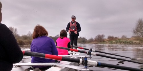 Experienced rower explaining the rowing sequence